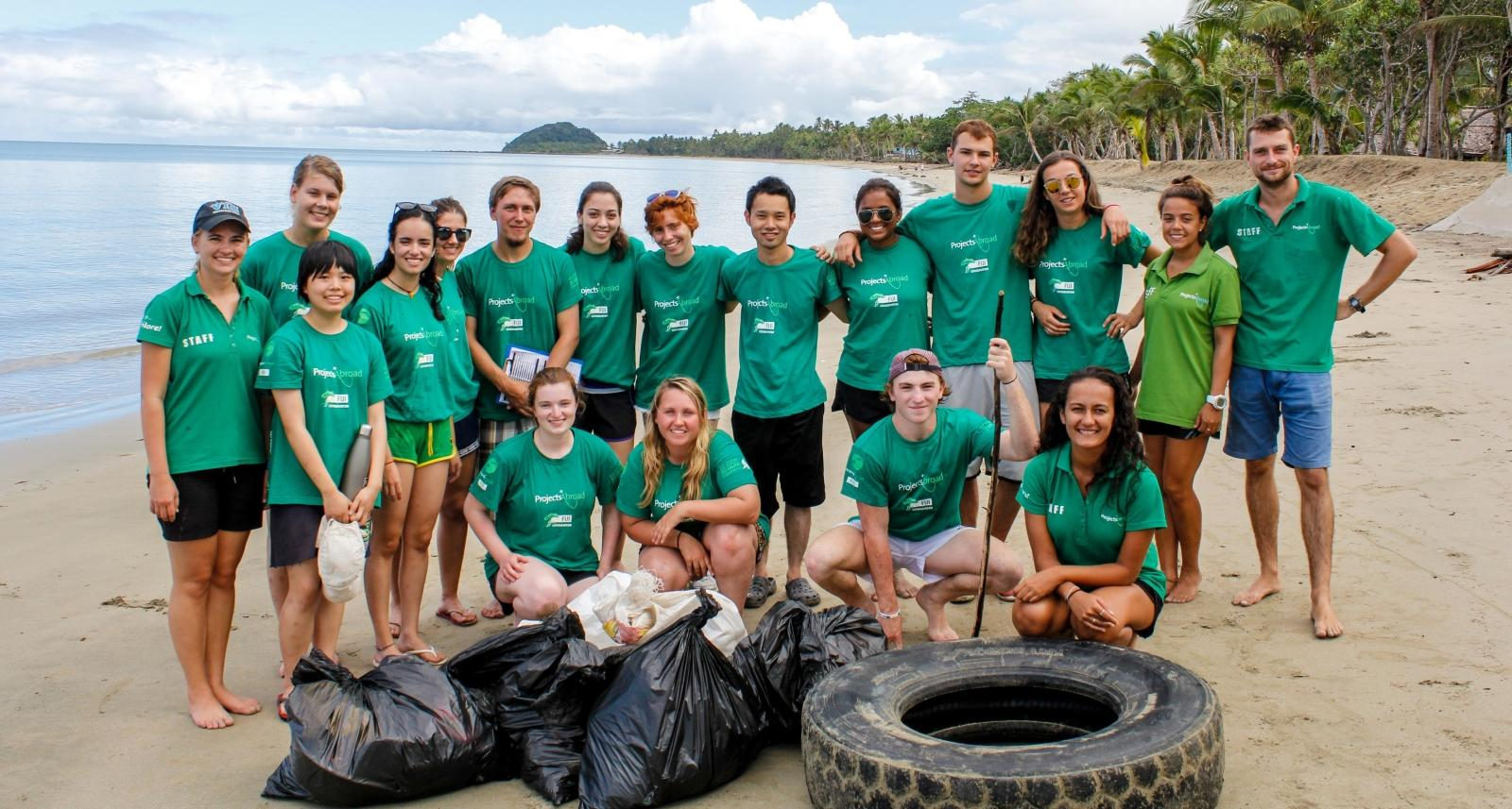 Projects Abroad volunteers pose after a successful beach clean up in Fiji
